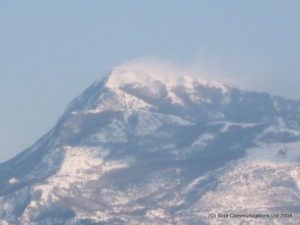 The north wind (the 'Bora') blowing the snow off the peak of Lovcen (1749m); February 2009